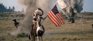 I opted against the gore, going for this shot instead. Spotted Wolf waves his white flag of surrender, along with the American flag which is later trampled as they assault the village. There was no pride for America to be had on this day.